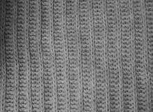 Fondo grigio dei lavori o indumenti a maglia Immagini Stock