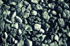 Fondo grigio di piccole pietre Immagini Stock