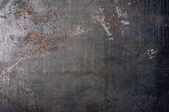Fondo grigio di struttura del metallo di lerciume con i graffi della ruggine fotografia stock libera da diritti