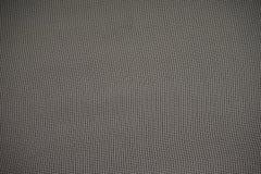 Fondo grigio di struttura della maglia fotografie stock libere da diritti