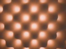 Fondo grigio ed arancio con struttura piena di bolle della spugna fotografia stock libera da diritti