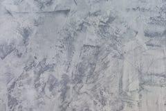 Fondo gris abstracto Textura de la pared enyesada desigual Masilla con las manchas y la aspereza La base para la disposici?n imagen de archivo libre de regalías