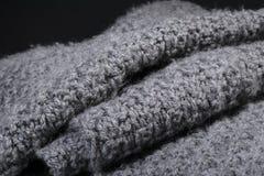Fondo gris arrugado de la textura de la tela de las lanas Imagenes de archivo