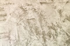 Fondo gris claro abstracto Pared del yeso de Straya con los rasguños y la aspereza La base para la disposici?n fotografía de archivo libre de regalías