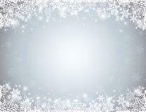 Fondo gris con el marco de copos de nieve Imágenes de archivo libres de regalías