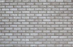Fondo gris de la pared de ladrillo Imágenes de archivo libres de regalías
