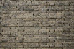 Fondo gris de la pared de ladrillo Fotografía de archivo libre de regalías