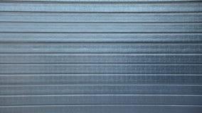 Fondo gris de la puerta del rodillo de la seguridad Fotografía de archivo