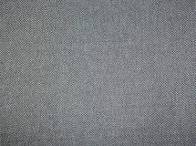 Fondo gris de la textura de la tela Fotografía de archivo