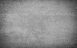 Fondo gris de piedra del muro de cemento del ladrillo áspero Imagenes de archivo