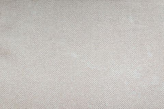 Fondo gris marrón claro de la textura de la tela del color Imagen de archivo libre de regalías