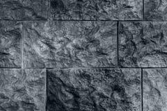 Fondo gris oscuro, pared del ladrillo del alivio fotografía de archivo libre de regalías