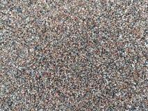Fondo grueso de la arena Piedras grandes y pequeñas Fondo imagen de archivo