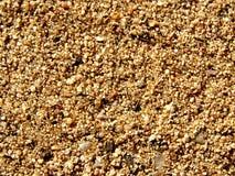 Fondo guijarroso de la textura de la arena imagenes de archivo