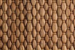 Fondo hecho a mano tejido bambú de la estera marrón Fotografía de archivo libre de regalías