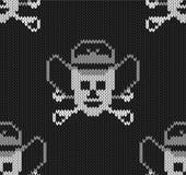 Fondo hecho punto con los cráneos en un sombrero de vaqueros libre illustration