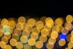 Fondo hermoso colorido del bokeh abstracto de oro ligero de la Navidad de la noche: con el espacio de la copia para añada el text Imagen de archivo