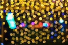Fondo hermoso colorido del bokeh abstracto de oro ligero de la Navidad de la noche: con el espacio de la copia para añada el text Foto de archivo libre de regalías