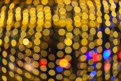 Fondo hermoso colorido del bokeh abstracto de oro ligero de la Navidad de la noche: con el espacio de la copia para añada el text Fotos de archivo libres de regalías