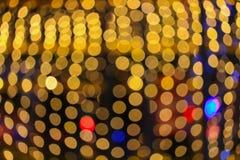 Fondo hermoso colorido del bokeh abstracto de oro ligero de la Navidad de la noche: con el espacio de la copia para añada el text Imagen de archivo libre de regalías