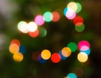 Fondo hermoso del arco iris con el bokeh borroso Feliz Navidad Foto de archivo libre de regalías