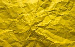Fondo Hoja de papel amarilla arrugada Imagenes de archivo