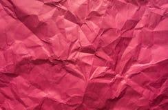 Fondo Hoja de papel rosada arrugada Fotografía de archivo