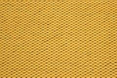 Fondo inconsútil amarillo de las tejas de tejado fotos de archivo