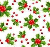 Fondo inconsútil con acebo de la Navidad. libre illustration