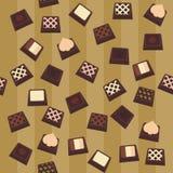 Fondo inconsútil con los caramelos de chocolate Imagen de archivo