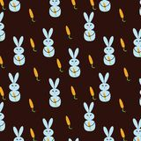 Fondo inconsútil con los conejos y las zanahorias imagen de archivo