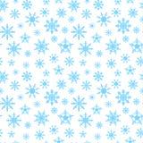 Fondo inconsútil con los copos de nieve azules Imagen de archivo