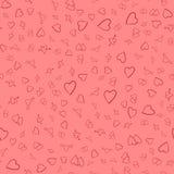 Fondo inconsútil de corazones rojos en el substrato rosado Fotos de archivo libres de regalías