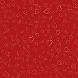 Fondo inconsútil de corazones rojos en un substrato rojo Fotografía de archivo libre de regalías