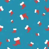 Fondo inconsútil de la Navidad con Santa Claus Shoes Imagen de archivo libre de regalías