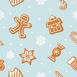Fondo inconsútil de la Navidad Hombre de pan de jengibre, casa, caramelos en azul en colores pastel Imagen de archivo