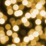 Fondo inconsútil de la Navidad de las luces del bokeh del oro Fotos de archivo
