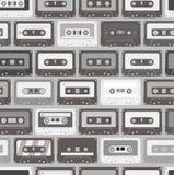Fondo inconsútil de los casetes audios Imagen de archivo libre de regalías