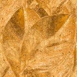 Fondo inconsútil de oro con las hojas decorativas de oro Imagenes de archivo