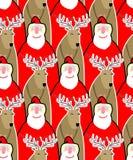 Fondo inconsútil de Santa Claus y del reno Ornamento franco del vector Fotos de archivo