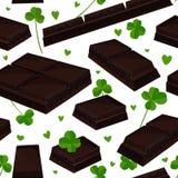 Fondo inconsútil del día del ` s de St Patrick con las hojas del trébol y las barras de chocolate Ilustración del vector Fotos de archivo