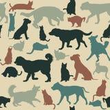 Fondo inconsútil del vintage con las siluetas de los gatos y de los perros Foto de archivo