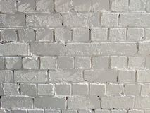 Fondo incons?til pintado blanco de la textura de la pared de ladrillo imágenes de archivo libres de regalías