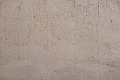 Fondo incrinato della parete della lastra di cemento armato Fotografie Stock