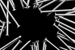 Fondo industrial de los clavos macros en negro Imagen de archivo libre de regalías