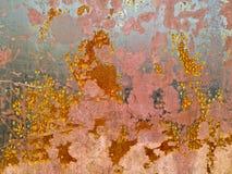 Fondo industrial rojo amarillo-naranja de la hoja de metal de la mancha rústica Imagen de archivo