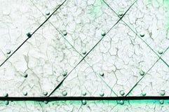 Fondo industriale verde chiaro del metallo con la pittura della sbucciatura Fotografia Stock