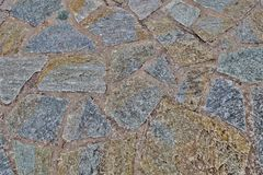Fondo insolito della parete di vecchie pietre fotografia stock libera da diritti