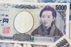 fondo japonés de 1000 y 5000 notas de la moneda Imagen de archivo