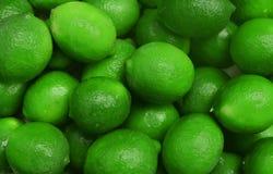 Fondo jugoso de la imagen con el verde lima maduro de las frutas jugoso Imagen de archivo libre de regalías